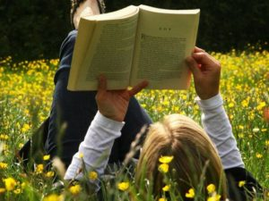 reading-a-book-in-field